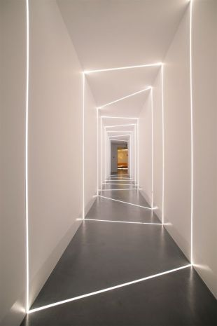 Isle on the Beiersdorf offices in Athens-Greece with led stripes incorporated into the concrete floor and drywall creating the effect of natural light entering through cuts on the wall. Design and implementation by the Love.it team found on love-it.gr