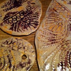 plates of white stoneware with purple, yellow glaze