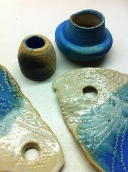 little vase, plates, candlestick, of white stoneware with blue, green glaze